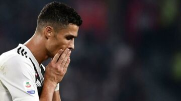 "(FILES) In this file photo taken on September 29, 2018 Juventus' Portuguese forward Cristiano Ronaldo reacts during the Italian Serie A football match Juventus vs Napoli at the Juventus stadium in Turin. Cristiano Ronaldo is ""doing well"" and will be ""ready to play"" this weekend, despite being caught in the storm of rape allegations, Juventus coach Massimiliano Allegri said on October 5, 2018. - Allegri said Ronaldo ""is in the squad and ready to play"" on Saturday when the winners of the past seven Serie A titles visit Udinese. (Photo by Marco BERTORELLO / AFP)"
