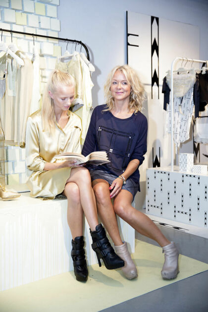 Danish designer Naja Munthe (R) together with a model during her show at the Copenhagen Fashion Week 2014, in Copenhagen, Denmark, 06 August 2014. The Spring/Summer 2015 collections are presented at the event from 03 to 08 August.