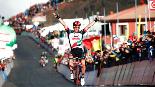 Slovenia's Jan Polanc of team UAE Emirates celebrates as he crosses the finish line to win the 4th stage of the 100th Giro d'Italia, Tour of Italy, cycling race from Cefalu to Etna volcano, on May 9, 2017 in Sicily. / AFP PHOTO / Luk BENIES