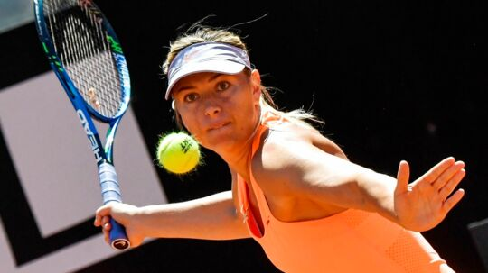 (FILES) This file photo taken on May 15, 2017 shows Maria Sharapova of Russia returning the ball to Christina McHale of US during their tennis match at the ATP Tennis Open tournament at the Foro Italico in Rome. Maria Sharapova has been granted a wildcard for next month's Women Tennis Association event in Birmingham, central England, organisers said Thursday, May 18, 2017. The decision came just a day after the Russian former world number one was refused a wildcard for the French Open following her 15-month ban for doping. / AFP PHOTO / ANDREAS SOLARO