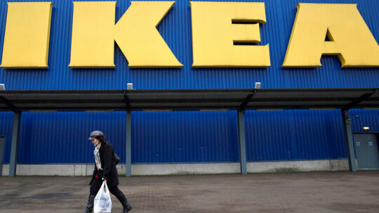 FILE PHOTO: A shopper walks past a sign outside an IKEA store in Wembley, north London, Britain, January 28, 2015. REUTERS/Neil Hall/File Photo