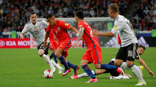 Soccer Football - Germany v Chile - FIFA Confederations Cup Russia 2017 - Group B - Kazan Arena, Kazan, Russia - June 22, 2017 Chile's Alexis Sanchez in action with Germany's Sebastian Rudy REUTERS/Maxim Shemetov