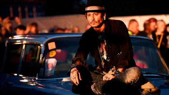 Skuespilleren Johnny Depp poserede på en Cadillac før han introducerede filmen »The Libertine« ved Cinemageddon på Glastonbury festivalen i Storbrittanien.