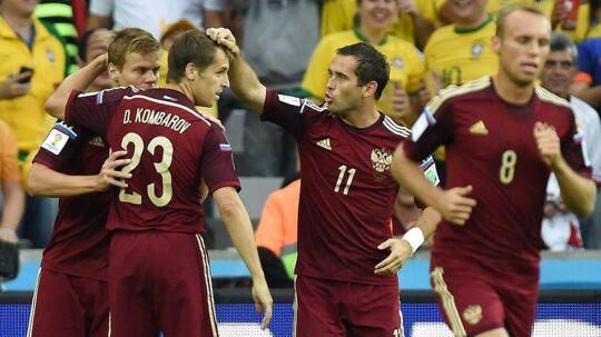 Rusland fejrer et mål under VM i 2014, hvor en rapport antyder, at spillerne var dopede.