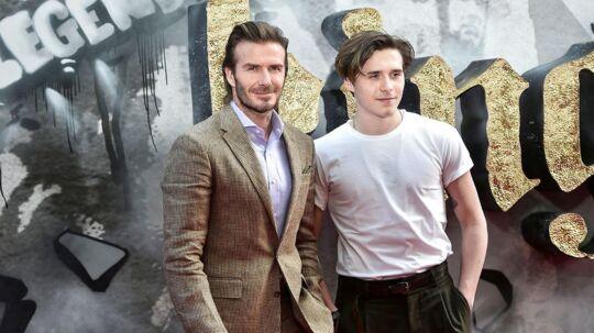 På billedet ses David Beckham med sin søn Brooklyn i forbindelse med filmpremieren på 'King Arthur'. London den 10. maj i år.