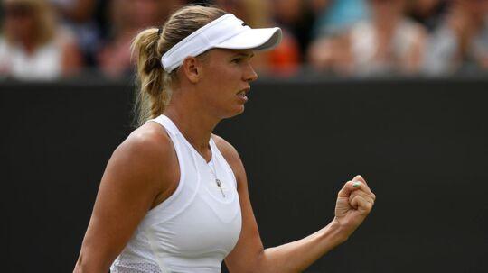 Caroline Wozniacki (bill.I) har muligheden for at vinde en Grand Slam, mener Martina Hingis, der mener, at der bare skal lidt justeringer af danskerens spil til, for at det lykkes.