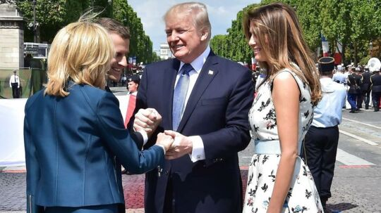 epa06087029 US President Donald J. Trump (2-R) shakes hands with French President Emmanuel Macron (2-L) and his wife Brigitte Macron (L), next to US First Lady Melania Trump, during the annual Bastille Day military parade on the Champs-Elysees avenue in Paris, France, 14 July 2017. The Bastille Day, the French National Day, is held annually on 14 July to commemorate the storming of the Bastille fortress in 1789. EPA/CHRISTOPHE ARCHAMBAULT / POOL MAXPPP OUT
