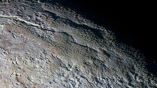 The bladed terrain of Tartarus Dorsa on the dwarf planet Pluto is seen in an undated image from NASA's New Horizons spacecraft. REUTERS/NASA/JHUAPL/SwRI/Handout via Reuters THIS IMAGE HAS BEEN SUPPLIED BY A THIRD PARTY. IT IS DISTRIBUTED, EXACTLY AS RECEIVED BY REUTERS, AS A SERVICE TO CLIENTS. FOR EDITORIAL USE ONLY. NOT FOR SALE FOR MARKETING OR ADVERTISING CAMPAIGNS