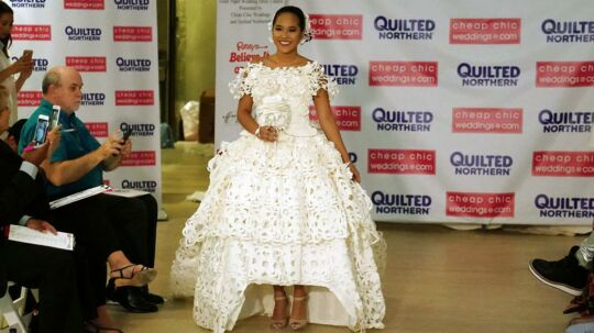 A model presents a wedding dress made out of toilet paper during a fashion show in the Manhattan borough of New York City, New York, U.S. July 20, 2017. REUTERS/Carlo Allegri