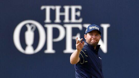 Branden Grace fejrer at have gået lørdagens runde ved British Open i 62 slag - det er rekord for turneringen og for alle majors i golf-historien.