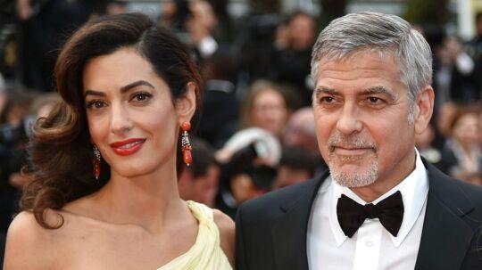 George Clooney vil sagsøge de fotografer, der har taget fotos af han og konen Amal Clooneys tvillinger.