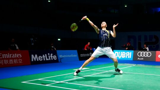 Victor Axelsen of Denmark returns a hit against K. Srikanth of India during the men's singles match during the Dubai World Superseries Finals badminton tournament in Dubai on December 10, 2015. AFP PHOTO / MARWAN NAAMANI