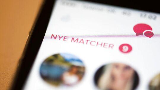 Arkivfotos af apps til smartphones: Tinder