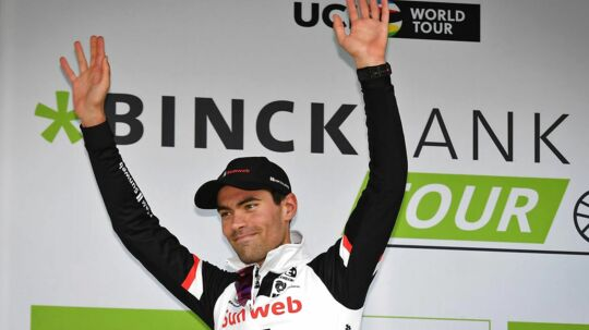 Netherland's Tom Dumoulin of Team Sunweb celebrates on the podium as the general leader after the fifth stage of the BinckBank Tour through Belgium and the Netherlands, 203, 7 km from Riemst to Houffalize, on August 12, 2017 in Houffalize. / AFP PHOTO / BELGA / DAVID STOCKMAN / Belgium OUT