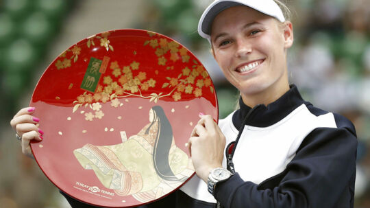 Caroline Wozniacki of Denmark holds the winning plate during an awarding ceremony after winning the final match against Anastasia Pavlyuchenkova of Russia at Pan Pacific Open Women's tennis tournament in Tokyo, Japan, in this photo taken by Kyodo September 24, 2017. Mandatory credit Kyodo/via REUTERS ATTENTION EDITORS - THIS IMAGE WAS PROVIDED BY A THIRD PARTY. MANDATORY CREDIT. JAPAN OUT.NO COMMERCIAL OR EDITORIAL SALES IN JAPAN. MANDATORY CREDIT