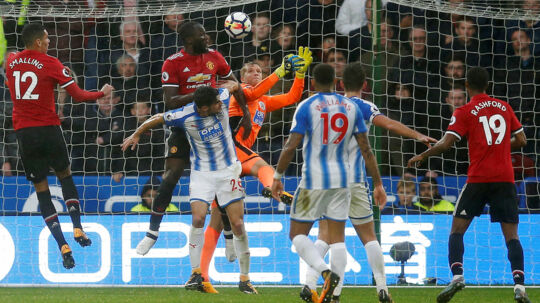 "Soccer Football - Premier League - Huddersfield Town vs Manchester United - John Smith's Stadium, Huddersfield, Britain - October 21, 2017 Manchester United's Romelu Lukaku in action with Huddersfield Town's Jonas Lossl and Christopher Schindler REUTERS/Andrew Yates EDITORIAL USE ONLY.No use with unauthorized audio, video, data, fixture lists, club/league logos or ""live"" services. Online in-match use limited to 75 images, no video emulation.No use in betting, games or single club/league/player publications. Please contact your account representative for further details."