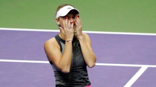 Caroline Wozniacki og hittingpartneren Sascha Bajin går hver til sit. Her ses danskeren efter sejren i sæsonfinalen i sidste måned.
