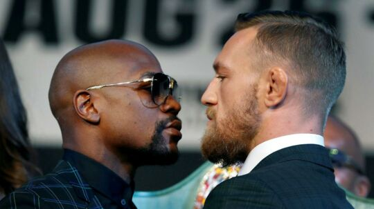 Undefeated boxer Floyd Mayweather Jr. (L) of the U.S. and UFC lightweight champion Conor McGregor