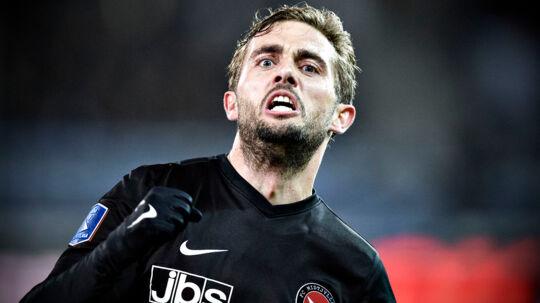 FC Midtjyllands Jakob Poulsen har scoret direkte på frispark til 1-0, mandag aften i superligakampen mod OB i Herning. /ritzau/Anita Graversen