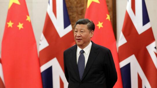 Det kinesiske kommunistparti foreslår, at fjerne begrænsningen for, hvor længe en præsident kan sidde. Dermed vil den nuværende præsident, Xi Jinping, kunne fortsætte efter 2023. Reuters/Pool