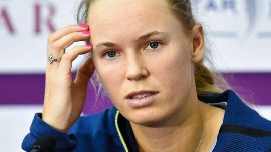 epa06537565 Caroline Wozniacki of Denmark talks to the media after losing her semi final match against Petra Kvitova of the Czech Republic at the WTA Qatar Ladies Open tennis tournament in Doha, Qatar, 17 February 2018. EPA/NOUSHAD THEKKAYIL