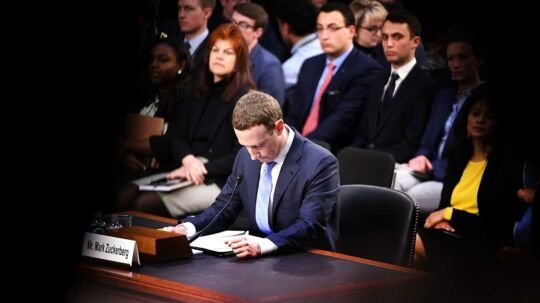 TOPSHOT - Facebook founder and CEO Mark Zuckerberg testifies during a Senate Commerce, Science and Transportation Committee and Senate Judiciary Committee joint hearing about Facebook on Capitol Hill in Washington, DC, April 10, 2018. Facebook chief Mark Zuckerberg apologized to US lawmakers Tuesday for the leak of personal data on tens of millions of users as he faced a day of reckoning before a Congress mulling regulation of the global social media giant. In his first-ever US congressional appearance, the Facebook founder and chief executive sought to quell the storm over privacy and security lapses at the social network that have angered lawmakers and Facebook's two billion users. / AFP PHOTO / JIM WATSON