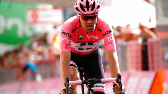 Pink jersey Netherlands' Tom Dumoulin of team Sunweb crosses the finish line of the 16th stage of the 100th Giro d'Italia, Tour of Italy, cycling race from Rovetta to Bormio on May 23, 2017. Italy's Vincenzo Nibali pipped Spanish rival Mikel Landa to victory in a dramatic 16th stage of the Giro d'Italia that saw depleted race leader Tom Dumoulin retain the pink jersey. / AFP PHOTO / Luk BENIES