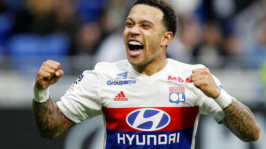 Soccer Football - Ligue 1 - Olympique Lyonnais vs Amiens SC - Groupama Stadium, Lyon, France - April 14, 2018 Lyon's Memphis Depay celebrates scoring their second goal REUTERS/Emmanuel Foudrot