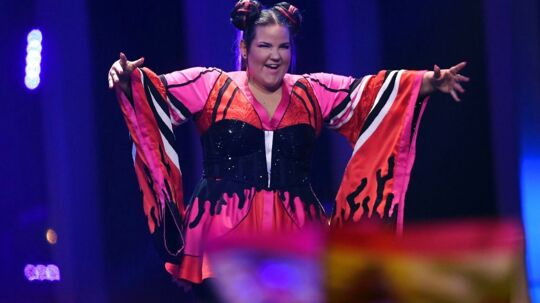 Israel's singer Netta Barzilai aka Netta reacts on stage during the final of the 63rd edition of the Eurovision Song Contest 2018 at the Altice Arena in Lisbon, on May 12, 2018. / AFP PHOTO / Francisco LEONG