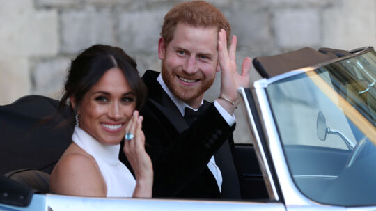 The newly married Duke and Duchess of Sussex, Meghan Markle and Prince Harry, leaving Windsor Castle after their wedding to attend an evening reception at Frogmore House, hosted by the Prince of Wales Windsor, Britain, May 19, 2018.. Steve Parsons/Pool via REUTERS