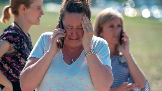NOBLESVILLE, IN - MAY 25: Instructional Assistant Paige Rose reacts outside Noblesville West Middle School after a shooting at the school on May 25, 2018 in Noblesville, Indiana. One teacher and one student were initially reported injured. Kevin Moloney/Getty Images/AFP == FOR NEWSPAPERS, INTERNET, TELCOS & TELEVISION USE ONLY ==