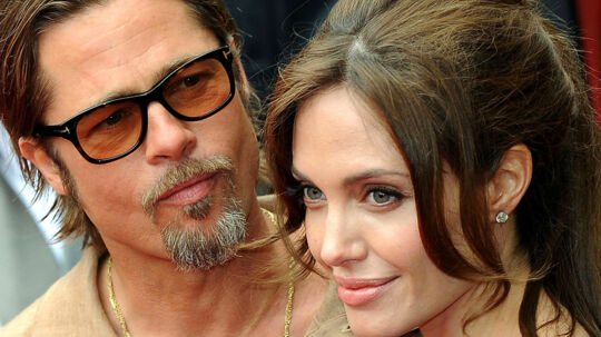 "Actors Brad Pitt and Angelina Jolie arrive on the red carpet for the Los Angeles premiere Of DreamWorks Animation's ""Kung Fu Panda 2"" at Grauman's Chinese Theatre in Hollywood, California. on May 22, 2011. AFP PHOTO/Mark RALSTON"