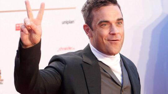 Robbie Williams skal snart være far, men er stadig klar med en fræk kommentar. Her er han fotograferet i Hamburg, september 2012.