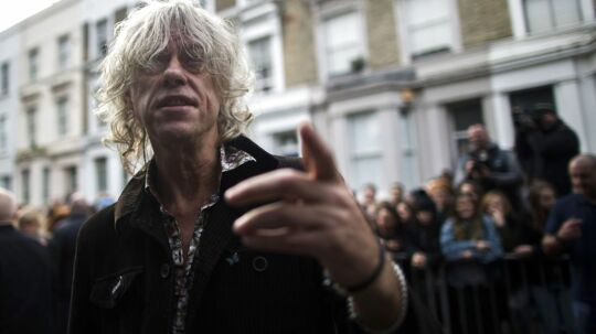 "Irish musician Bob Geldof arrives at a west London studio to record the new Band Aid 30 single on November 15, 2014. Bob Geldof, One Direction, Bono and some 30 other stars gathered in a studio in London on Saturday to record a 30th anniversary version of the Band Aid charity single to raise money to fight Ebola. Led Zeppelin's Robert Plant, Coldplay's Chris Martin and Sinead O'Connor were also among the rockers brought together by Geldof to sing the fourth version of ""Do They Know It's Christmas?"" Musicians began arriving in the early morning and were expected to record all day and into the night before the single is aired for the first time on Sunday and then officially released on Monday. AFP PHOTO / ANDREW COWIE"