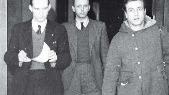 Karl Heinz Hoffmann blev efter befrielsen dømt til døden, dommen blev ændret til 20 års fængsel, men han blev senere benådet og udvist af landet i 1952. Her føres han (th.) til politigården i København.