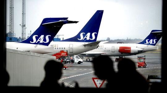 Nu skal økonomipassagerene på SAS' lange ruter selv betale, hvis de vil hav en øl eller et glas vin til maden.