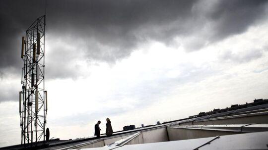 Mørke skyer samler sig over telebranchen i Danmark, som skruer ned for investeringerne generelt, trods særlig indsats for at få de nye 4G-/LTE-supermobilnet op at køre i hele landet. Arkivfoto: Jeppe Bøje Nielsen, Scanpix
