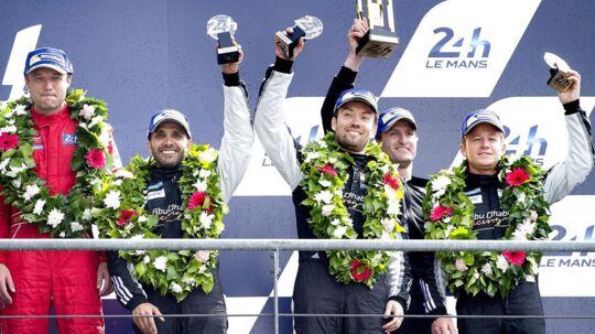 Eneste dansker på podiet i årets udgave af Le Mans blev David Heinemeier-Hansson (i midten) der i sin Porche sluttede på en flot tredjeplads.