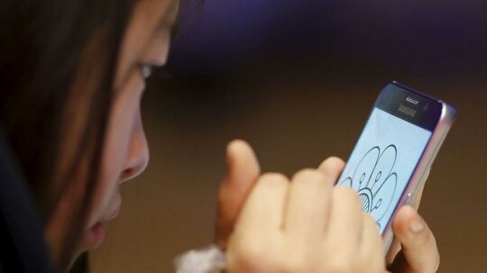 Samsung springer direkte fra Galaxy Note 5 til 7, når den nye toptelefon præsenteres i London tirsdag aften. Galaxy Note-serien kommer med digital pen, som bruges til både at tegne og skrive med og til at kunne klikke sig rundt på skærmen med. Arkivfoto: Kim Hong-Ji, Reuters/Scanpix