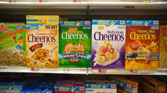 Boxes of General Mills Cheerios breakfast cereals in the grocery department of a store in New York on Wednesday, June 28, 2011. General Mills announced that it will cut up to 600 jobs globally.