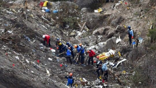 "- - AFP PICTURES OF THE YEAR 2015 - - French gendarmes and investigators work on March 26, 2015 in the scattered debris on the crash site of the Germanwings Airbus A320 that crashed in the French Alps above the southeastern town of Seyne. The young co-pilot of the doomed Germanwings flight that crashed on March 24, appears to have ""deliberately"" crashed the plane into the French Alps after locking his captain out of the cockpit, but is not believed to be part of a terrorist plot, French officials said on March 26, 2015. AFP PHOTO / ANNE-CHRISTINE POUJOULAT"